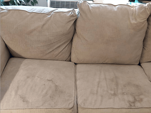 dirty couch that needs steam cleaning