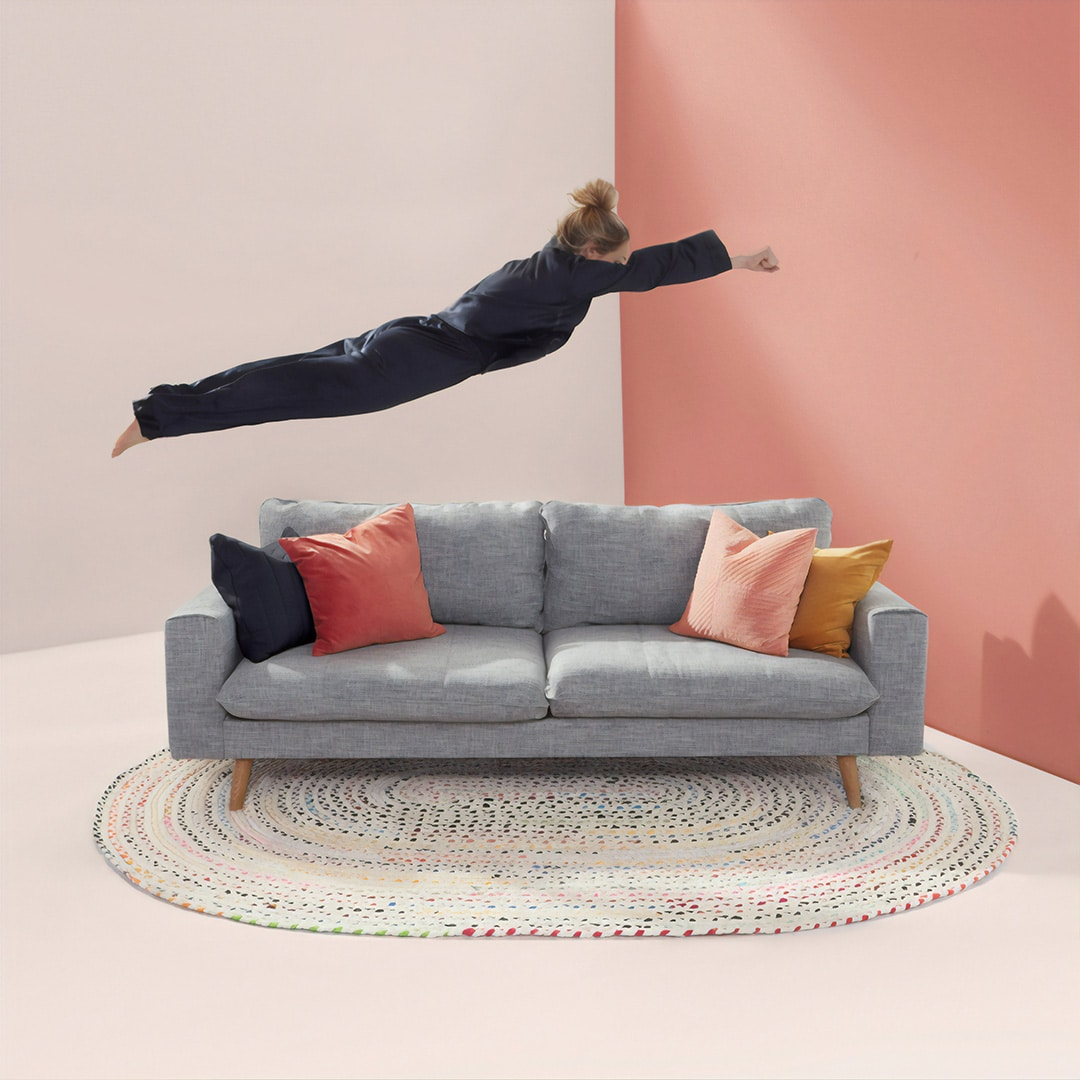 woman jumping on clean couch